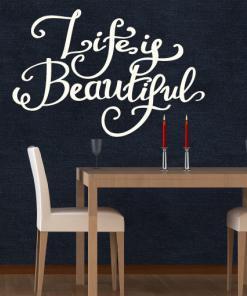Primer izgleda bele samolepilne stenske nalepke Life is beautiful 2 na črni steni. Nalepka je napis, ki se glasi: Life is beautiful 2.