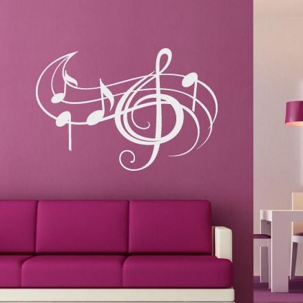 Primer izgleda bele stenska nalepka Note in violinski ključ 2 na roza steni.