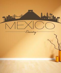 Primer izgleda čokoladno rjave samolepilne stenske nalepke Mexico ukrivljen na bež steni v dnevni sobi.