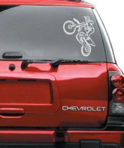 Primer izgleda bele samolepilne avto nalepke Motocross extreme na avtu rdeče barve.
